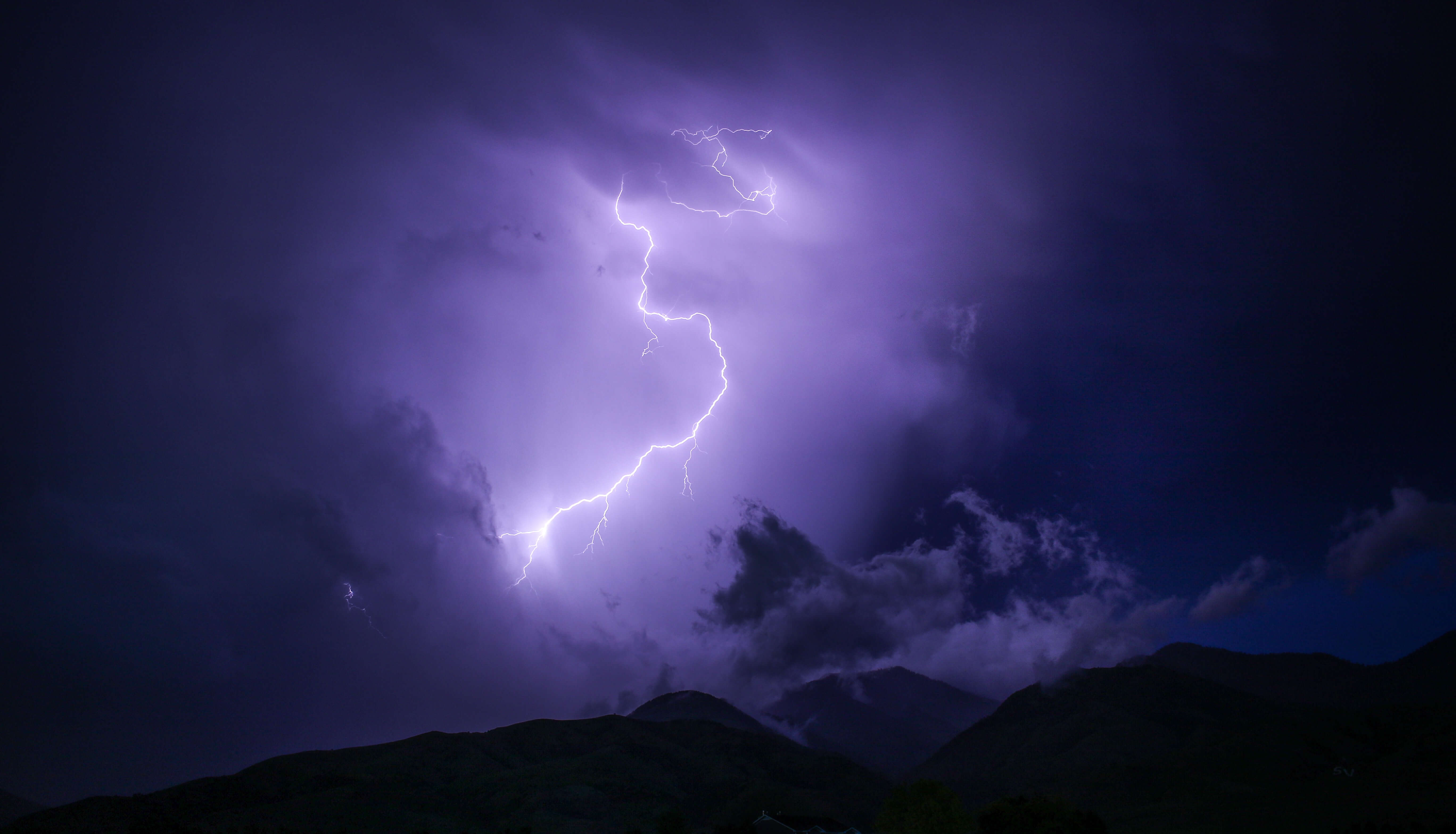 Lightning Strike in Dark Mountains